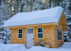cozy-tiny-house-covered-in-snow